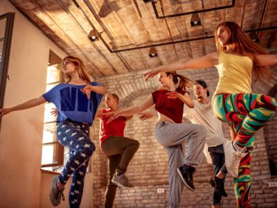 Group of young modern dancers dancing in the studio. Sport, dancing and urban culture concept